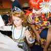 Kenzie Kirby, left, age 4 works on her Halloween mask with help from Derda Rec Center pre-school teacher Lois Bohling during the Spooktacular event at the Broomfield First Bank Center on Saturday.<br /> <br /> photo/ Matt Kelley