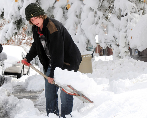 Richie Cline shovels snow along Coral Way after the spring snow storm on Wednesday.<br /> <br /> March 24, 2010<br /> Staff photo/David R. Jennings