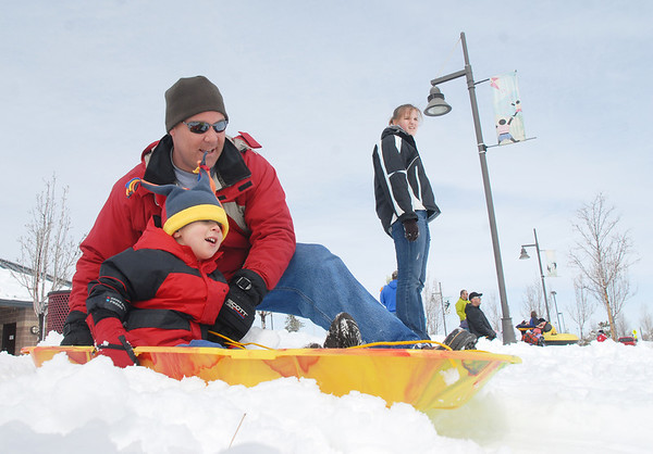 Erik Geiser pushes his son Connor, 3 1/2, down the slope while sledding at Commons Park on Wednesday.<br /> <br /> March 24, 2010<br /> Staff photo/David R. Jennings