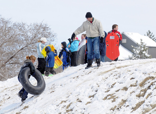 Sledders and tubers try their skills on the slopes of Loc Amora Open Space after the snow storm on Wednesday.<br /> <br /> March 24, 2010<br /> Staff photo/David R. Jennings