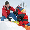 Erik Geiser pushes his son Connor, 3 1/2, down the slope while sledding at Commons Park on Wednesday.<br /> <br /> <br /> March 24, 2010<br /> Staff photo/David R. Jennings