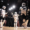 Members of the 501st Legion Mountain Garrison escort Darth Vader off the stage during the Star Wars fundraiser for the Broomfield Public Library Foundation on Sunday at the Audi. <br /> <br /> August 7, 2011<br /> staff photo/ David R. Jennings