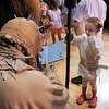 Sophia Suissa, 5, holds a staff while a member of the Rebel Legion dressed as a Sand Person signs his autograph for her during the Star Wars fundraiser for the Broomfield Public Library Foundation on Sunday at the Audi. <br /> <br /> August 7, 2011<br /> staff photo/ David R. Jennings