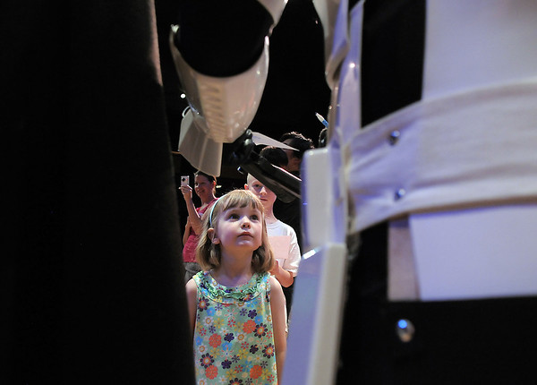 Ashley Acton, 5, waits to get an autograph from a storm trooper from the 501st Legion Mountain Garrison during the Star Wars fundraiser for the Broomfield Public Library Foundation on Sunday at the Audi. <br /> <br /> August 7, 2011<br /> staff photo/ David R. Jennings