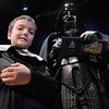 Riley Suissa, 8, left, waits while Darth Vader, portrayed by a member of the 501st Legion Mountain Garrison, signs his autograph during the Star Wars fundraiser for the Broomfield Public Library Foundation on Sunday at the Audi. <br /> <br /> August 7, 2011<br /> staff photo/ David R. Jennings