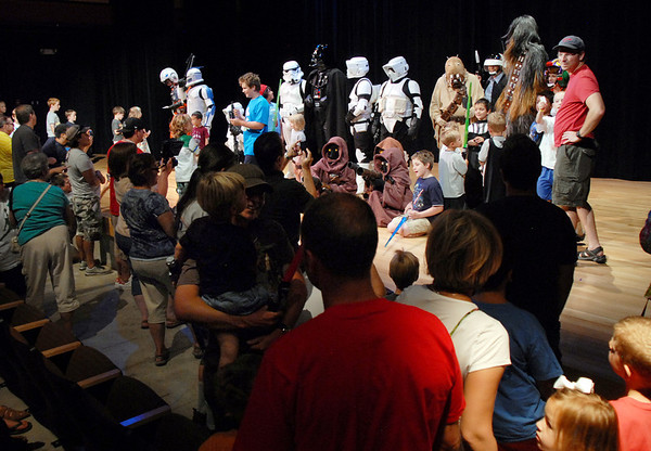 People flock to the stage to pose for pictures and get autographs with members of  he Rebel Legion and the 501st Legion Mountain Garrison during the Star Wars fundraiser for the Broomfield Public Library Foundation on Sunday at the Audi. <br /> <br /> August 7, 2011<br /> staff photo/ David R. Jennings