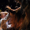 Sophia Suissa, 5, gives a high five to a member of the Rebel Legion portraying a Wookie at the Star Wars fundraiser for the Broomfield Public Library Foundation on Sunday at the Audi. <br /> <br /> August 7, 2011<br /> staff photo/ David R. Jennings