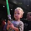 Canaan Barthlow, 3, wields his plastic green light saber on stage at the Star Wars fundraiser for the Broomfield Public Library Foundation on Sunday at the Audi. <br /> <br /> August 7, 2011<br /> staff photo/ David R. Jennings
