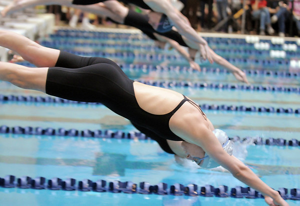 Silver Creek's Kylie Rembert launches off the blocks for the 200 yard IM at the 4A state swimming championships on Saturday at the Veterans Memorial Aquatics Center in Thornton.<br /> February 11, 2012<br /> staff photo/ David R. Jennings