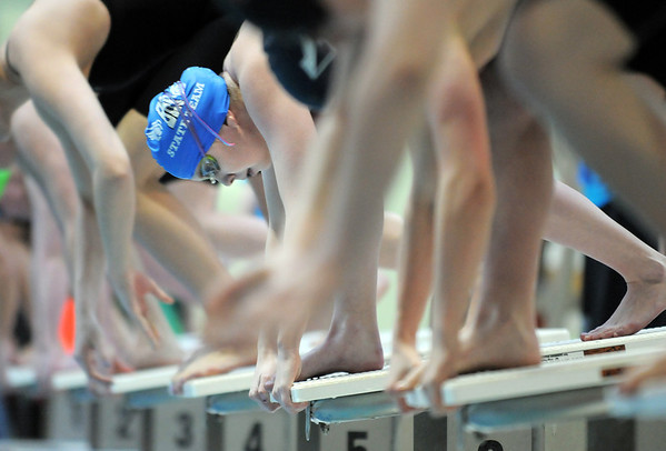 Broomfield's Heather Shaver readies to launch off the blocks for the 50 yard freestyle at the 4A state swimming championships on Saturday at the Veterans Memorial Aquatics Center in Thornton.<br /> February 11, 2012<br /> staff photo/ David R. Jennings