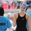 Broomfield's Katalena Laufasa-Duncan gives a high five before swimming in the 200 yard IM at the 4A state swimming championships on Saturday at the Veterans Memorial Aquatics Center in Thornton.<br /> February 11, 2012<br /> staff photo/ David R. Jennings