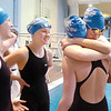 Broomfield's Katalena Laufasa-Duncan, right, gives Heather Shaver a hug as teammates Elizabeth Peterson and Kendall Wingfield watch as the 200 yard medley relay team prepares for the finals at the 4A state swimming championships on Saturday at the Veterans Memorial Aquatics Center in Thornton.<br /> February 11, 2012<br /> staff photo/ David R. Jennings