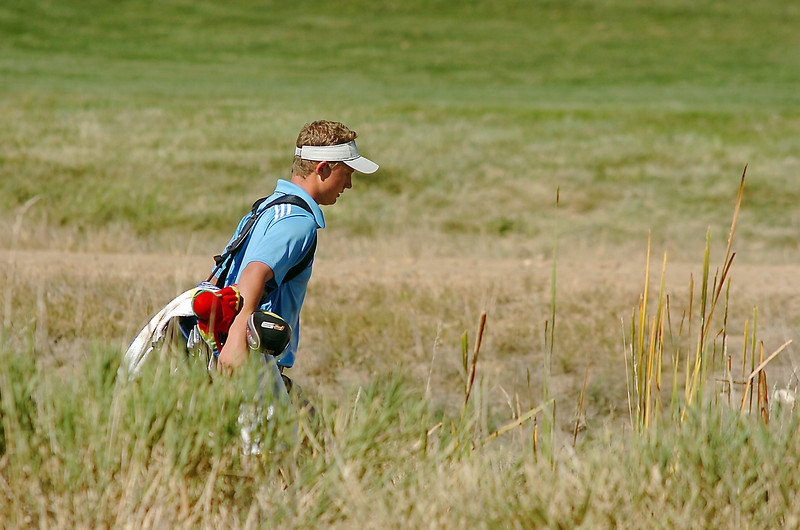 Broomfield's Nick Reisch walks through the rough on the 6th hole during the state 4A golf tournament at Pelican Lakes Golf course in Windsor on Tuesday.<br /> October 4, 2011<br /> staff photo/ David R. Jennings