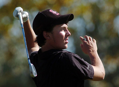 Silver Creek's Dylan Wonnacott tees off the 4th hole during the state 4A golf tournament at Pelican Lakes Golf course in Windsor on Tuesday. October 4, 2011 staff photo/ David R. Jennings