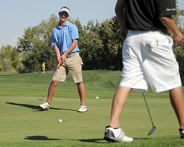 Broomfield's Nick Reisch watches his putt on the 1st tee as Silver Creek's Dylan Wonnacott walks by during the state 4A golf tournament at Pelican Lakes Golf course in Windsor on Tuesday. October 4, 2011 staff photo/ David R. Jennings