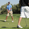 Broomfield's Nick Reisch watches his putt on the 1st tee as Silver Creek's Dylan Wonnacott walks by during the state 4A golf tournament at Pelican Lakes Golf course in Windsor on Tuesday.<br /> October 4, 2011<br /> staff photo/ David R. Jennings