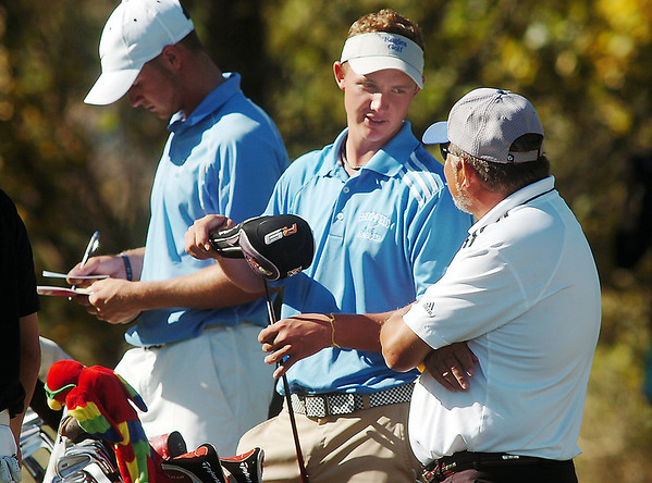 Broomfield's Nick Reisch, center, talk with his coach John Ferraro, right, with Valor Christian's Dylan Wonnacott, left, during the state 4A golf tournament at Pelican Lakes Golf course in Windsor on Tuesday.<br /> October 4, 2011<br /> staff photo/ David R. Jennings