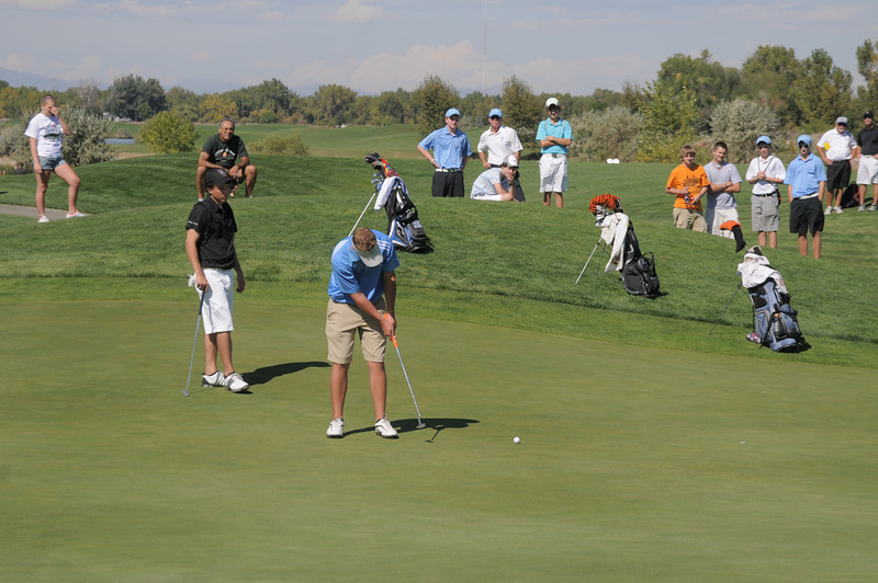 Broomfield's Nick Reisch, center,  makes a putt on the on the 5th green  during the state 4A golf tournament at Pelican Lakes Golf course in Windsor on Tuesday.<br /> October 4, 2011<br /> staff photo/ David R. Jennings