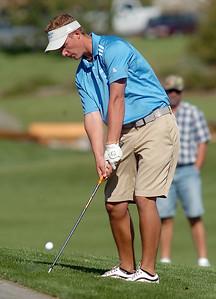 Broomfield's Nick Reisch chips onto the 1st green during the state 4A golf tournament at Pelican Lakes Golf course in Windsor on Tuesday. October 4, 2011 staff photo/ David R. Jennings