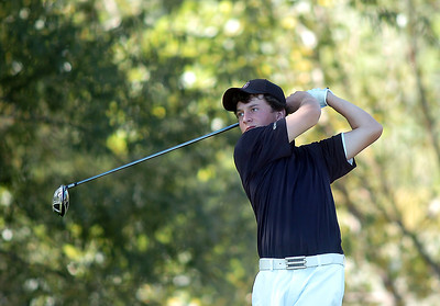 Silver Creek's Dylan Wonnacott tees of the 2nd hole during the state 4A golf tournament at Pelican Lakes Golf course in Windsor on Tuesday. October 4, 2011 staff photo/ David R. Jennings