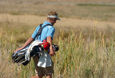Broomfield's Nick Reisch walks through the rough on the 6th hole during the state 4A golf tournament at Pelican Lakes Golf course in Windsor on Tuesday. October 4, 2011 staff photo/ David R. Jennings