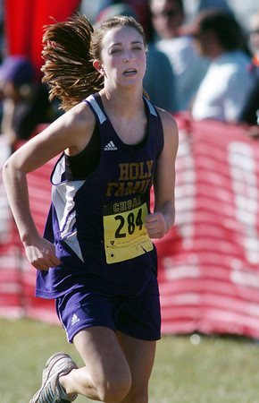Holy Family's Danielle Medearis runs to the finish line at the state cross country meet at Fossil Ridge High School in Ft. Collins on Saturday.<br /> <br /> November 7, 2009<br /> Staff photo/David R. Jennings