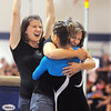 Broomfield gymnastics coach Diane Clark hugs JoJo Hayden while asistant coach Erika Taga cheers after Hayden's vault during the state 5A gymnatics meet at Thornton High School on Friday.<br /> <br /> November 6, 2009<br /> Staff photo/David R. Jennings