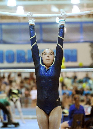 Legacy's Maddie Riva performs on the bars during the state 5A gymnatics meet at Thornton High School on Friday.<br /> <br /> November 6, 2009<br /> Staff photo/David R. Jennings