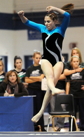 Melissa Moonie, Broomfield, performs her  floor routine during the state 5A gymnatics meet at Thornton High School on Friday.<br /> <br /> November 6, 2009<br /> Staff photo/David R. Jennings