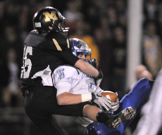 Broomfield's Nick Ongarato catches a pass against Monarch's Geoff Clary during the quarterfinals 4A game at Centaurus High on Friday.<br /> November 18, 2011<br /> staff photo/ David R. Jennings