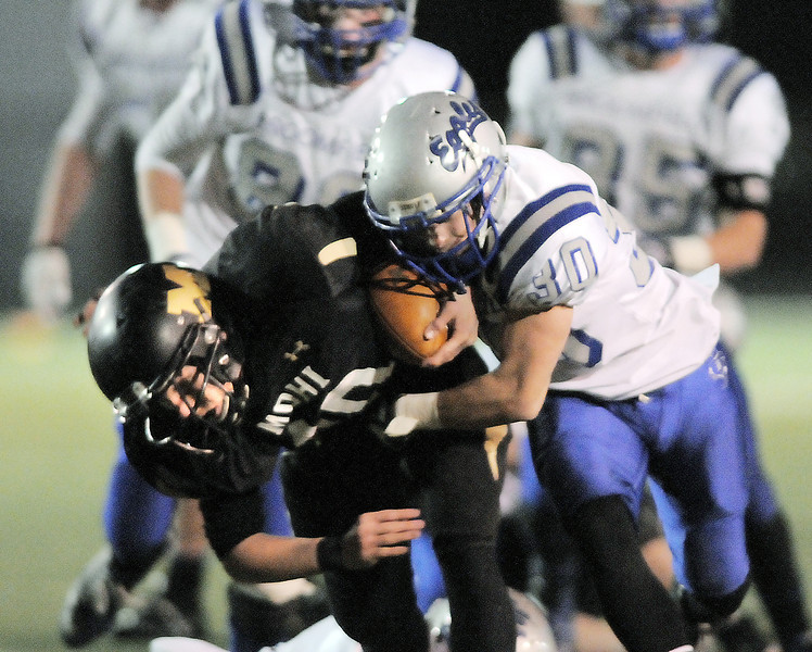 Monarch's Dylan Glazer is tackled by Broomfield's Lee Cannon during the quarterfinals 4A game at Centaurus High on Friday.<br /> November 18, 2011<br /> staff photo/ David R. Jennings
