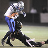 After catching a pass Broomfield's Dan Perse is tackled by Monarch's Geoff Clary during the quarterfinals 4A game at Centaurus High on Friday.<br /> November 18, 2011<br /> staff photo/ David R. Jennings