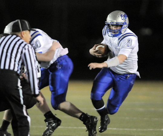 Broomfield's quarterback Angelo Perez runs the ball downfield against Monarch during the quarterfinals 4A game at Centaurus High on Friday.<br /> November 18, 2011<br /> staff photo/ David R. Jennings