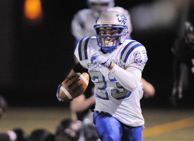 After catching a pass, Broomfield's Jose Faire carries the ball in for a touchdown against Monarch in the last part of the fourth quarter during the quarterfinals 4A game at Centaurus High on Friday. November 18, 2011 staff photo/ David R. Jennings