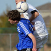Holy Family's Matt O'Hayre goes for a header against Peak to Peak's David Griffith during Saturday's state playoff game at Mike G. Gabriel Stadium.<br /> October 25, 2012<br /> staff photo/ David R. Jennings