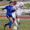 Peak to Peak's Moritz Zerwes and Holy Family's Zachery Burk fight for control of the ball during Saturday's state playoff game at Mike G. Gabriel Stadium.<br /> October 25, 2012<br /> staff photo/ David R. Jennings