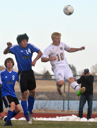 Peak to Peak's Chris Quinn, left, and Holy Family's Jay Elliott go up for a header during Saturday's state playoff game at Mike G. Gabriel Stadium.<br /> October 25, 2012<br /> staff photo/ David R. Jennings