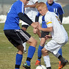 Holy Family's Patrick Borer, right, and Peak to Peak's Tomas Lopez Del Carril fight for control of the ball during Saturday's state playoff game at Mike G. Gabriel Stadium.<br /> October 25, 2012<br /> staff photo/ David R. Jennings