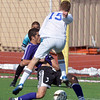 BBroomfield's Connor Metzger kicks the ball under Denver North's Jose Gutierrez during Saturday's state playoff game at Elizabeth Kennedy Stadium.<br /> October 25, 2012<br /> staff photo/ David R. Jennings