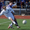 Broomfield's Porter Milner kicks the ball downfield  Denver North's Fernando Gutierrez during Saturday's state playoff game at Elizabeth Kennedy Stadium.<br /> October 25, 2012<br /> staff photo/ David R. Jennings