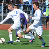 Broomfield's Connor Metzger and Noah Chapleski take the ball downfield against Denver North during Saturday's state playoff game at Elizabeth Kennedy Stadium.<br /> October 25, 2012<br /> staff photo/ David R. Jennings