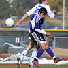 Broomfield's Jacob Bellendir goes for a header against Denver North's Devon Soto during Saturday's state playoff game at Elizabeth Kennedy Stadium.<br /> October 25, 2012<br /> staff photo/ David R. Jennings