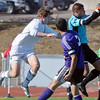 Broomfield's Jacob Bellendir goes up against Denver North's goalie Jose Diaz and Jose Gutierrez during Saturday's state playoff game at Elizabeth Kennedy Stadium.<br /> October 25, 2012<br /> staff photo/ David R. Jennings