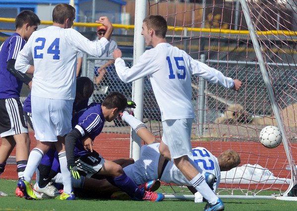 Broomfield's Thomas Adelmann (22) amkes another goal against Denver North during Saturday's state playoff game at Elizabeth Kennedy Stadium.<br /> October 25, 2012<br /> staff photo/ David R. Jennings