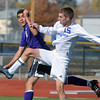 Broomfield's Connor Metzger fights for the ball with Denver North's Jose Gutierrez during Saturday's state playoff game at Elizabeth Kennedy Stadium.<br /> October 25, 2012<br /> staff photo/ David R. Jennings