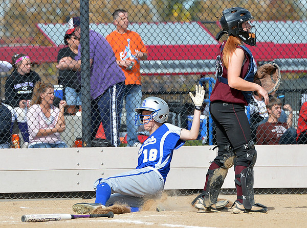 Broomfield's Katie Sterling slides home past Berthoud's Lauren Bending during Friday's state softball championships at Aurora Sports Park.<br /> <br /> October 19, 2012<br /> staff photo/ David R. Jennings