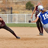 Berthoud's Sami Kouns tries to catch the ball while Broomfield's Shelby Grandt turns at second base during Friday's state softball championships at Aurora Sports Park.<br /> <br /> <br /> October 19, 2012<br /> staff photo/ David R. Jennings