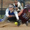 Broomfield's Katelin Knudsen collides with Berthoud's Morgan Thonhoff at third base  during Friday's state softball championships at Aurora Sports Park.<br /> <br /> October 19, 2012<br /> staff photo/ David R. Jennings