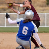 Berthoud's Sami Kouns tags out Broomfield's Lyndsey Babcock at second base during Friday's state softball championships at Aurora Sports Park.<br /> <br /> October 19, 2012<br /> staff photo/ David R. Jennings
