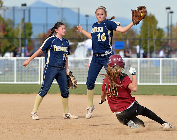 Frederick's Antonia Villani catches the ball at second base as Ponderosa's Erin Fincher slides to the base during Friday's state softball championships at Aurora Sports Park.<br /> <br /> October 19, 2012<br /> staff photo/ David R. Jennings